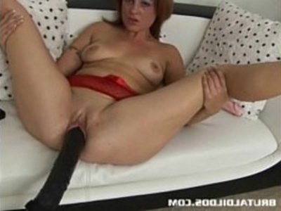 Brunette is plowed by a brutal dildo machine | brunette   brutal   dildo   insertion   kinky   masturbation   sex machine   sex toys   solo